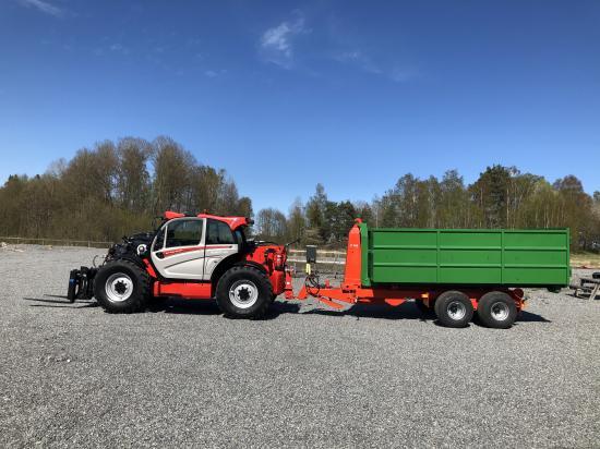 Manitou MLT 1040-145PS L+ Elite med en lastväxlarvagn är en mäktig uppenbarelse.