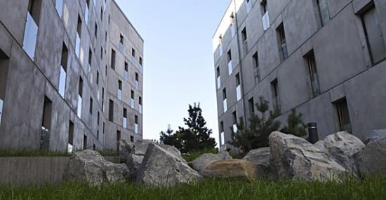 Kvarteret Forskningens grå betonghus fångar upp stenarna i miljön runtomkring och blir en förlängning av berget som de står på.
