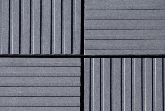 Cembrit Patina Inline - en ny fasadskiva i fibercement med linjerad yta. Mönstereffekter och spännande kontraster kan skapas genom olika montage och möten med andra naturmaterial.