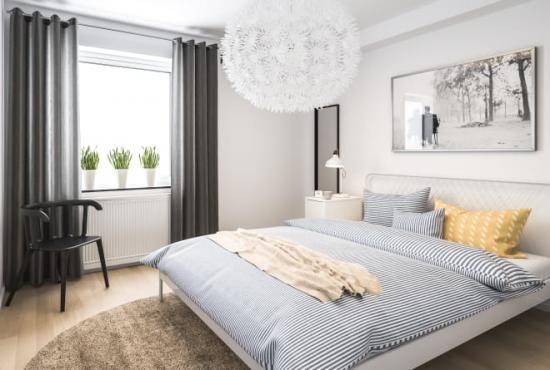 Illustration över hur en sovrumsinteriör i lägenhet kan komma att se ut i Skegrie.
