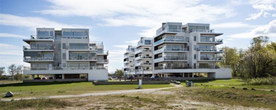 Likartade bostäder, som NCC tidigare byggt i Lomma strand åt samma kund.