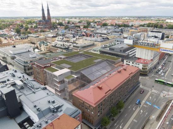 Flygvy från öster över förslag till utbyggnad i kvarteret Sala. Illustration Wåhlin arkitekter (observera att bilden är ett fotomontage och att slutresultatet kan komma att se annorlunda ut).